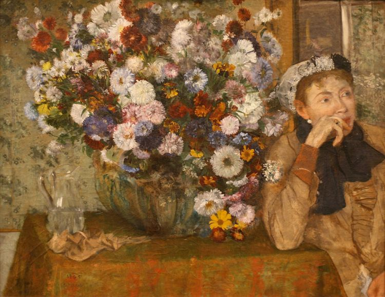 Degas woman seated by a vase of flowers
