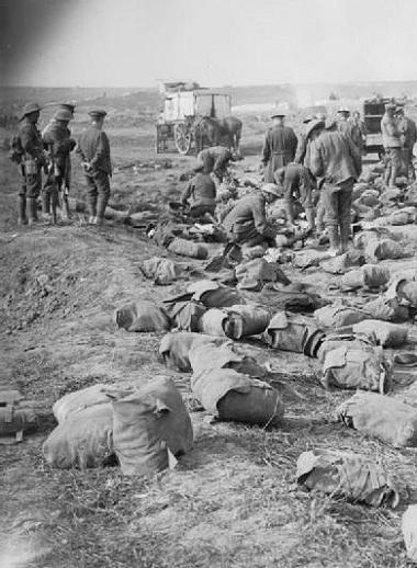 RAMC_search_packs_of_British_dead_after_Battle_of_Guillemont_1916_IWM_Q_4245
