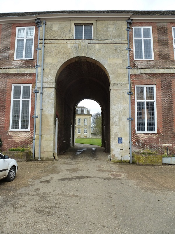 The unfinished wing, seen through the stable block