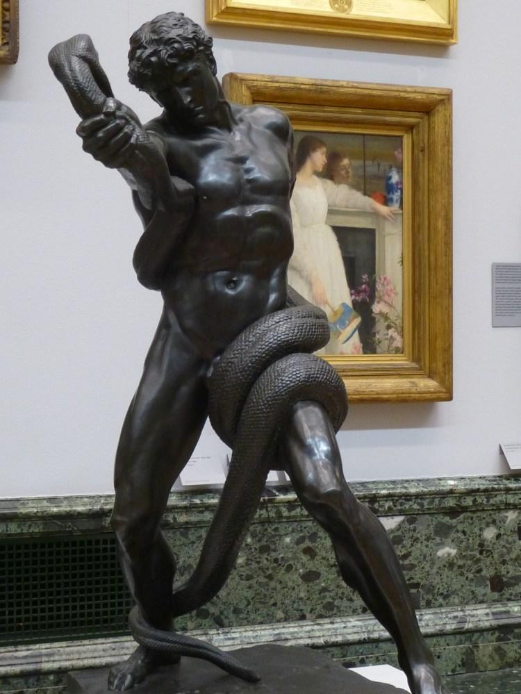 Leighton, an athlete wrestling with a python 1